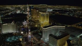 DCA03_021 - 4K stock footage aerial video of panning across Las Vegas Boulevard, from Treasure Island to the Venetian, Las Vegas, Nevada, Night