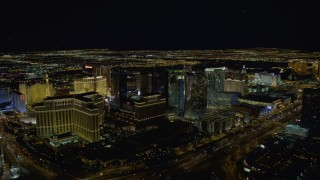 DCA03_022 - 4K stock footage aerial video of the back of The Bellagio, Aria Resort, Paris, Planet Hollywood, Las Vegas, Nevada Night