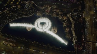 DCA03_025 - 4K stock footage aerial video of flying away from Bellagio Fountain water show, revealing The Bellagio, Las Vegas, Nevada Night
