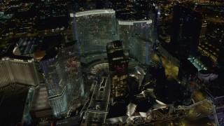 DCA03_031 - 4K stock footage aerial video of flying by Aria Resort, Mandarin Oriental, Veer Towers, Las Vegas, Nevada Night
