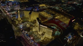 DCA03_042 - 4K aerial stock footage video of Paris and Planet Hollywood Resort and Casino, Las Vegas, Nevada Night