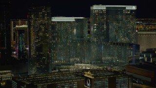 DCA03_049 - 4K stock footage aerial video of approaching Aria Resort and Casino, Las Vegas, Nevada Night