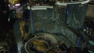 DCA03_050 - 4K stock footage aerial video of ascending near Aria Resort and Casino, Las Vegas, Nevada Night
