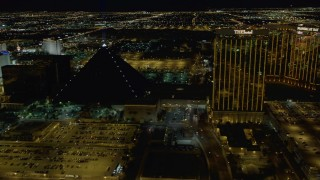 DCA03_051 - 4K stock footage aerial video of flying by Luxor Hotel, The Hotel, Mandalay Bay Resort, Las Vegas, Nevada Night