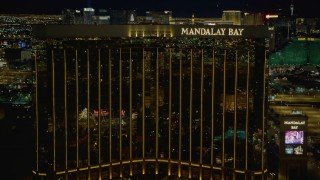 DCA03_054 - 4K stock footage aerial video of approaching Mandalay Bay, Las Vegas, Nevada Night