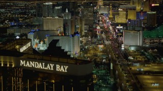 DCA03_056 - 4K stock footage aerial video of Las Vegas Blvd from Mandalay Bay to MGM Grand, reveal Excalibur, New York New York, Las Vegas, Nevada Night