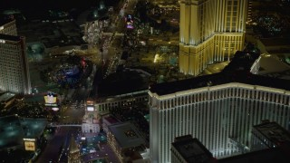 DCA03_064 - 4K stock footage aerial video of Las Vegas Boulevard surrounded by hotels, Las Vegas, Nevada Night