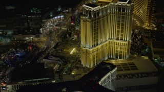 DCA03_065 - 4K stock footage aerial video of flying by Palazzo from Las Vegas Boulevard, Las Vegas, Nevada Night