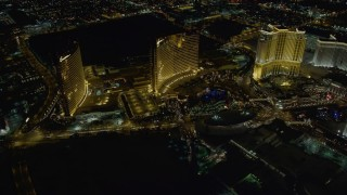 DCA03_067 - 4K stock footage aerial video of flying by Encore, Wynn, The Palazzo, Las Vegas, Nevada Night