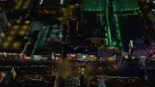 DCA03_071 - 4K stock footage aerial video of Las Vegas Boulevard and the MGM Grand, Tropicana, Las Vegas, Nevada Night
