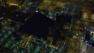 DCA03_073 - 4K stock footage aerial video of flying by Luxor Hotel and Casino, Las Vegas, Nevada Night