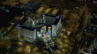 DCA03_074 - 4K stock footage aerial video of flying away from Excalibur Hotel and Casino, Las Vegas, Nevada Night