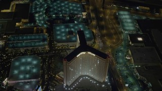 DCA03_079 - 4K stock footage aerial video of flying by The Mirage, revealing Treasure Island, Las Vegas, Nevada Night