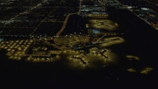 DCA03_103 - 4K stock footage aerial video of McCarran International Airport, Las Vegas, Nevada Night
