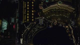 DCA03_118 - 4K stock footage aerial video of bird's eye view of The Bellagio, The Bellagio Fountain, Caesar's Palace, Las Vegas, Nevada Night