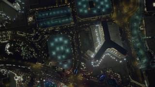 DCA03_120 - 4K stock footage aerial video of bird's eye view of The Mirage, Treasure Island, Las Vegas Boulevard, Nevada Night
