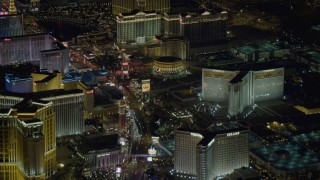 DCA03_122 - 4K stock footage aerial video tilt to reveal hotels along Las Vegas Strip, Nevada Night