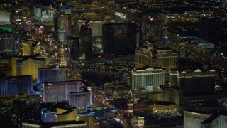 DCA03_123 - 4K stock footage aerial video tilt up on Las Vegas Boulevard, revealing hotels on Las Vegas Strip, Nevada Night