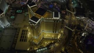 DCA03_127 - 4K stock footage aerial video orbit The Palazzo, Las Vegas, Nevada Night