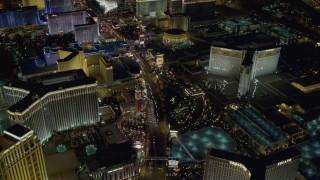DCA03_128 - 4K stock footage aerial video tilt to reveal hotels along the Las Vegas Strip, Nevada Night