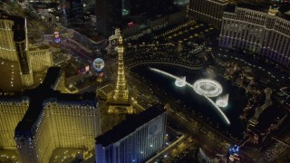 DCA03_130 - 4K stock footage aerial video of orbiting the water show at The Bellagio, Las Vegas, Nevada Night