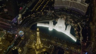 DCA03_134 - 4K stock footage aerial video of orbiting The Bellagio fountain at the end of the show, Las Vegas, Nevada Night