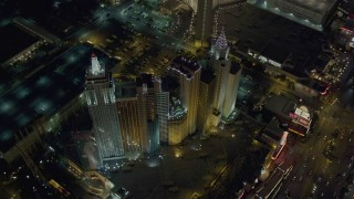 DCA03_144 - 4K stock footage aerial video tilt to bird's eye view of New York New York Hotel and Casino, Las Vegas, Nevada Night