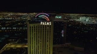 DCA03_152 - 4K stock footage aerial video of approaching and orbiting Palms Casino Resort, Las Vegas, Nevada Night