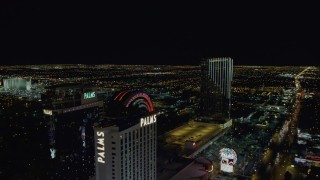 DCA03_154 - 4K stock footage aerial video of flying by Palms Casino toward Palms Place Hotel and Spa, Las Vegas, Nevada Night