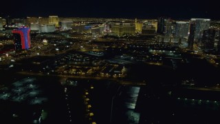 DCA03_156 - 4K stock footage aerial video of panning across the Las Vegas Strip revealing hotels, Nevada Night