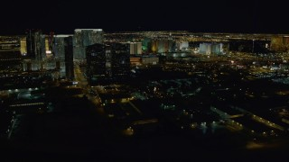 DCA03_157 - 4K stock footage aerial video of approaching hotels on Las Vegas Strip, Nevada Night