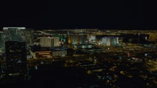 DCA03_158 - 4K stock footage aerial video of approaching hotels on Las Vegas Strip, Nevada Night