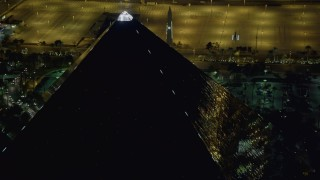 DCA03_161 - 4K stock footage aerial video of orbiting the top of Luxor Hotel and Casino, Las Vegas, Nevada Night