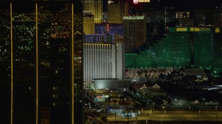 DCA03_163 - 4K stock footage aerial video of flying by Mandalay Bay, revealing hotels on Las Vegas Boulevard, Nevada Night
