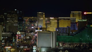 DCA03_164 - 4K stock footage aerial video of hotels along Las Vegas Boulevard, Nevada Night