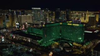 DCA03_165 - 4K stock footage aerial video of flying by MGM Grand, Las Vegas, Nevada Night