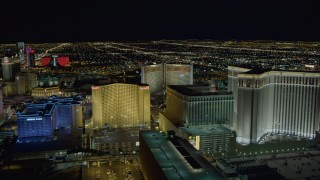 DCA03_170 - 4K stock footage aerial video of flying behind Imperial Palace and Harrah's, Las Vegas, Nevada Night