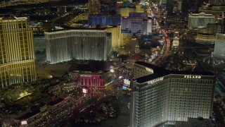 DCA03_174 - 4K stock footage aerial video of hotels along Las Vegas Boulevard, including Treasure Island, Nevada Night
