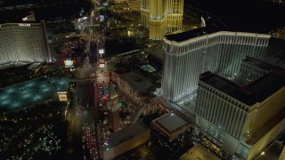 DCA03_177 - 4K stock footage aerial video of flying over hotels and Las Vegas Boulevard, Nevada Night