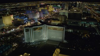 DCA03_178 - 4K stock footage aerial video of orbiting the Mirage Hotel and Casino, Las Vegas, Nevada Night