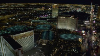 DCA03_181 - 4K stock footage aerial video of hotels on Las Vegas Boulevard, Mirage Hotel and Casino, Nevada Night