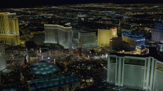 DCA03_183 - 4K stock footage aerial video of approaching The Venetian Resort and Casino, Las Vegas, Nevada Night