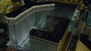DCA03_184 - 4K stock footage aerial video of approaching and orbiting The Venetian Resort and Casino, Las Vegas, Nevada Night