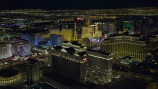 DCA03_188 - 4K stock footage aerial video tilt from Caesar's Palace and flyby hotels on Las Vegas Strip, Nevada Night
