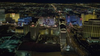 DCA03_189 - 4K stock footage aerial video of panning across Las Vegas Strip, zooming in on Caesar's Palace, Nevada Night