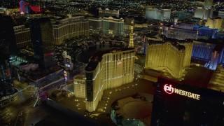 DCA03_201 - 4K stock footage aerial video orbit Planet Hollywood Resort and Casino, Las Vegas, Nevada Night