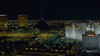DCA03_217 - 4K stock footage aerial video of zooming in on Luxor Hotel and Casino, Las Vegas, Nevada Night