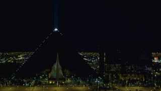 DCA03_218 - 4K stock footage aerial video of Luxor Hotel and Casino, Las Vegas, Nevada Night