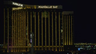 DCA03_219 - 4K stock footage aerial video of flying by Luxor Hotel and Casino, revealing Mandalay Bay, Las Vegas, Nevada Night