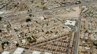 DCA04_003 - 4K stock footage aerial video flying over suburbs and warehouses in East Las Vegas, Nevada